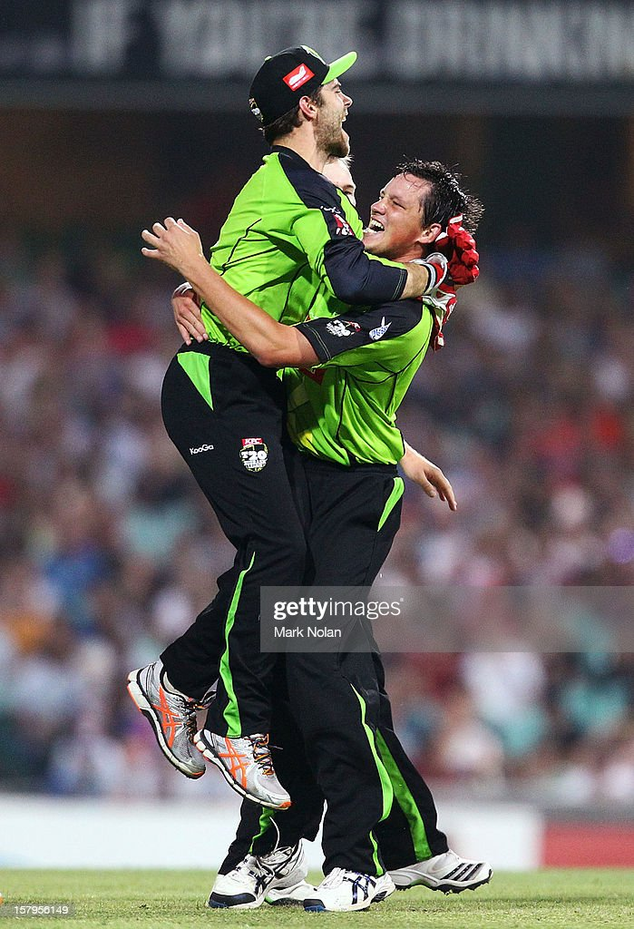 Chris Tremain of the Thunder celebrates with team mate Ryan Carters after getting the wicket of David Warner of the Sixers during the Big Bash League match between the Sydney Sixers and the Sydney Thunder at Sydney Cricket Ground on December 8, 2012 in Sydney, Australia.