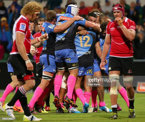 Chris TuataraMorrison of the Force celebrates with team mates after scoring a try during the round 15 Super Rugby match between the Western Force and...