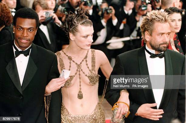 Chris Tucker Milla Jovovich and Director Luc Besson arrive for the premiere of The Fifth Element at the 50th Cannes Film Festival