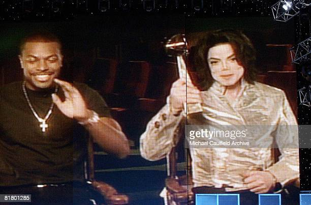 Chris Tucker presents Michael Jackson with a special Billboard Award for his 1982 album 'Thriller' which spent more weeks at No 1 than any other...