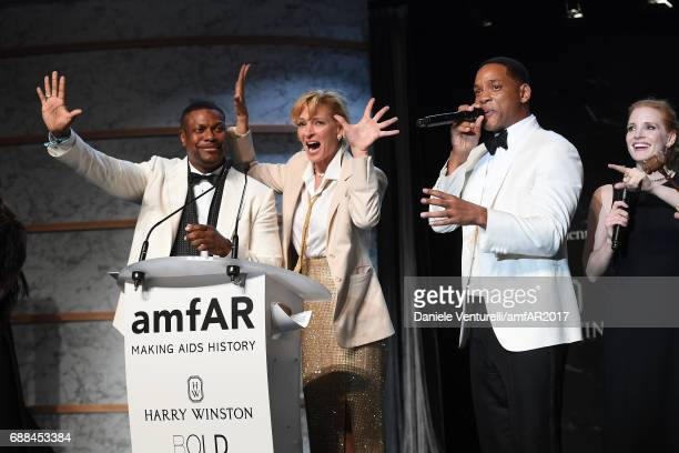 Chris Tucker Uma Thurman Will Smith and Jessica Chastain are seen on stage at the amfAR Gala Cannes 2017 at Hotel du CapEdenRoc on May 25 2017 in Cap...