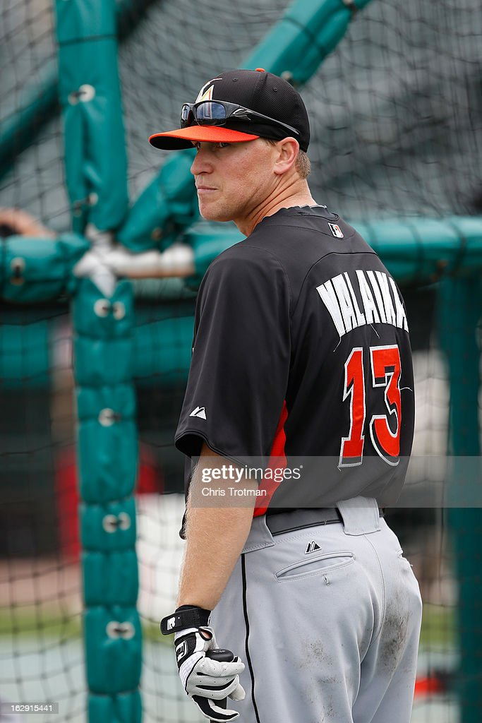 Chris Valaika #13 of the Miami Marlins looks on during batting practice prior to the game against the St. Louis Cardinals the Roger Dean Stadium on February 28, 2013 in Jupiter, Florida.