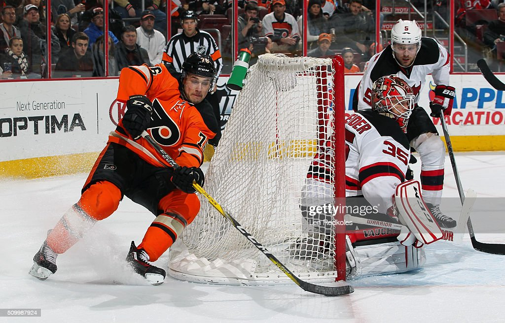 <a gi-track='captionPersonalityLinkClicked' href=/galleries/search?phrase=Chris+VandeVelde&family=editorial&specificpeople=5123038 ng-click='$event.stopPropagation()'>Chris VandeVelde</a> #76 of the Philadelphia Flyers attempts a backhand scoring chance against <a gi-track='captionPersonalityLinkClicked' href=/galleries/search?phrase=Cory+Schneider&family=editorial&specificpeople=696908 ng-click='$event.stopPropagation()'>Cory Schneider</a> #35 and <a gi-track='captionPersonalityLinkClicked' href=/galleries/search?phrase=Adam+Larsson&family=editorial&specificpeople=6705080 ng-click='$event.stopPropagation()'>Adam Larsson</a> #5 of the New Jersey Devils on February 13, 2016 at the Wells Fargo Center in Philadelphia, Pennsylvania.