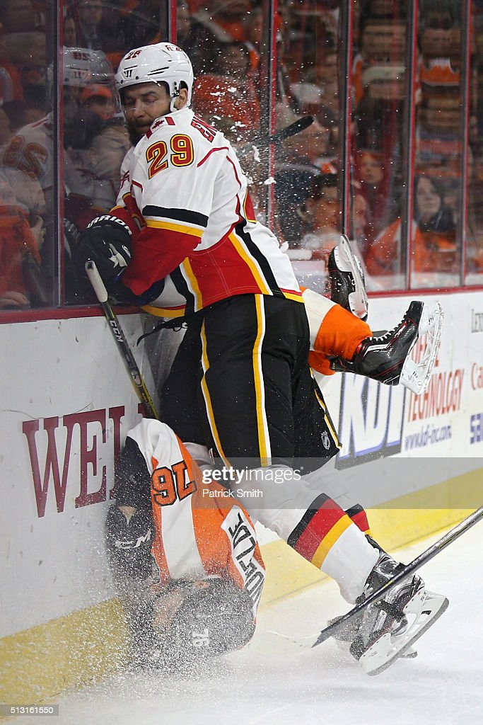 Chris VandeVelde #76 of the Philadelphia Flyers is checked by Deryk Engelland #29 of the Calgary Flames during the second period at Wells Fargo Center on February 29, 2016 in Philadelphia, Pennsylvania.