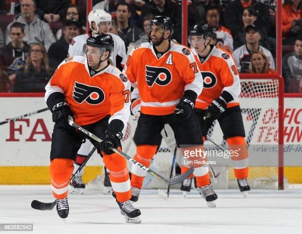 Chris VandeVelde PierreEdouard Bellemare and Ivan Provorov of the Philadelphia Flyers skate back on defense against the Ottawa Senators on March 28...