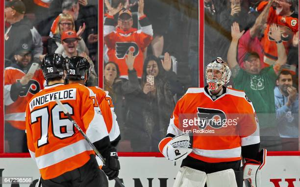 Chris VandeVelde PierreEdouard Bellemare and Steve Mason of the Philadelphia Flyers celebrate after defeating the Florida Panthers 21 in a shootout...