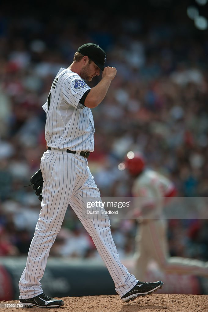 <a gi-track='captionPersonalityLinkClicked' href=/galleries/search?phrase=Chris+Volstad&family=editorial&specificpeople=4175503 ng-click='$event.stopPropagation()'>Chris Volstad</a> #31 of the Colorado Rockies reacts after giving up an eighth-inning home run to <a gi-track='captionPersonalityLinkClicked' href=/galleries/search?phrase=John+Mayberry+Jr.&family=editorial&specificpeople=4959058 ng-click='$event.stopPropagation()'>John Mayberry Jr.</a> #15 of the Philadelphia Phillies at Coors Field on June 15, 2013 in Denver, Colorado. The Rockies beat the Phillies 10-5.
