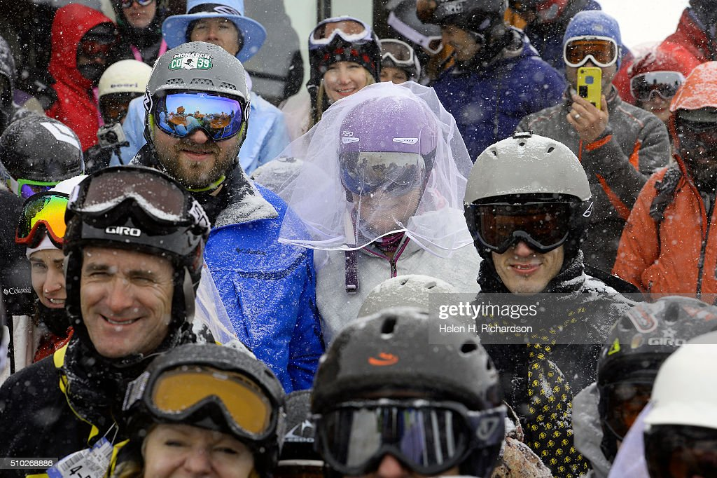 Chris Wacinski, in blue and his wife Heather, in purple helmet and vail, joined 100 other couples at the 25th annual Mountaintop Matrimony Valentine's day wedding ceremony on February 14, 2016 at the Loveland Ski area near Georgetown, Colorado. The couple have been married for 5 years and came from Lakewood to renew their wedding vows. The ceremony was held at Ptarmigan Roost cabin at the top of Ptarmigan lift. Approximately 100 couples got married or renewed their vows with minister Harry Heilmann, of the Universal Life Church, overseeing the ceremony.