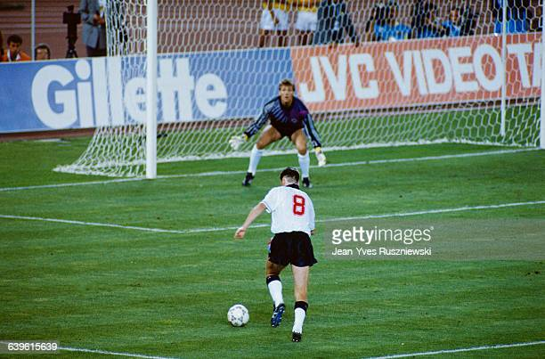 Chris Waddle and goalkeeper Bodo Illgner during the semifinal of the 1990 Soccer World Cup between West Germany and England