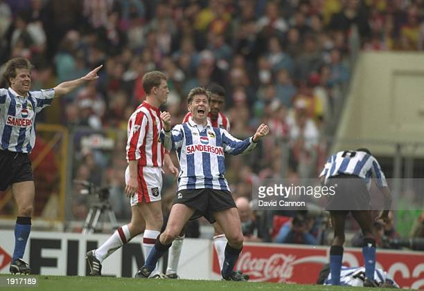 Chris Waddle of Sheffield Wednesday celebrates after their victory in the FA Cup semifinal against Sheffield United at Wembley Stadium in London...