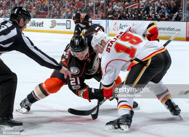 Chris Wagner of the Anaheim Ducks and Matt Stajan of the Calgary Flames compete for the faceoff during the first period of the game at Honda Center...