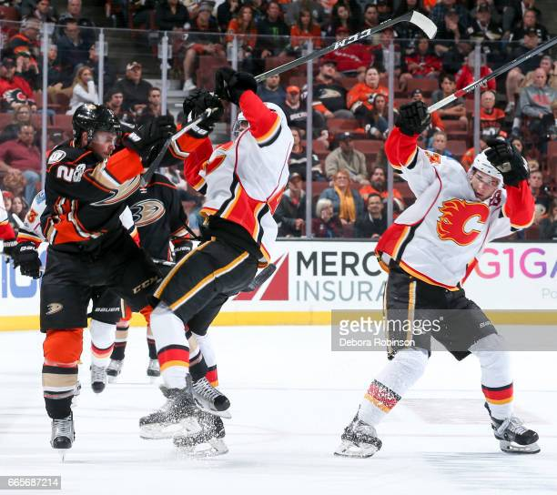 Chris Wagner of the Anaheim Ducks collides with Matt Bartkowski of the Calgary Flames as Sean Monahan ducks during the third period of the game at...