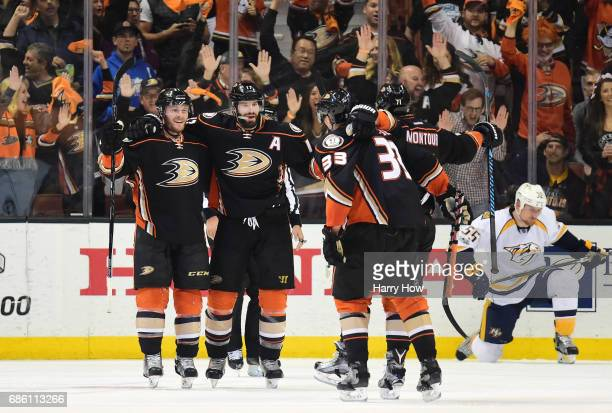 Chris Wagner Ryan Kesler Jakob Silfverberg and Brandon Montour of the Anaheim Ducks celebrate Wagner's goal as Cody McLeod of the Nashville Predators...