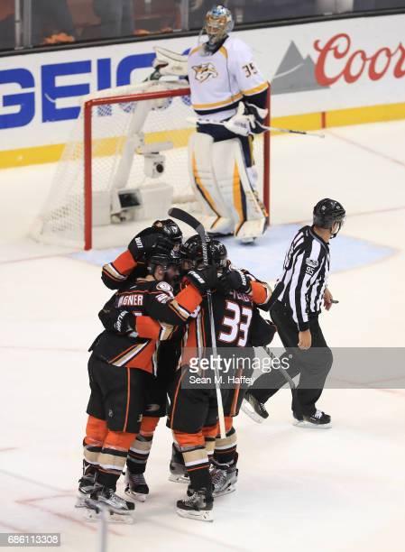 Chris Wagner Ryan Kesler Jakob Silfverberg and Brandon Montour of the Anaheim Ducks celebrate Wagner's goal as Pekka Rinne of the Nashville Predators...