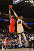 Chris Walker of the Houston Rockets shoots the ball after the game Jason Thompson of the Golden State Warriors on October 15 2015 at Oracle Arena in...