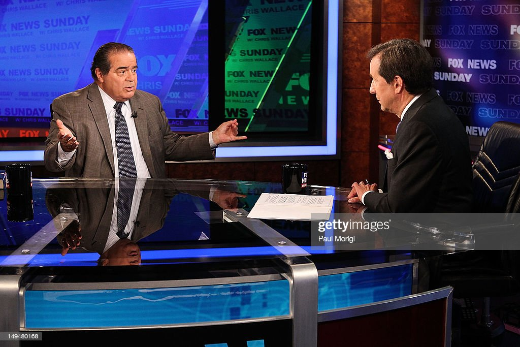 Chris Wallace (R) interviews U.S. Supreme Court Justice <a gi-track='captionPersonalityLinkClicked' href=/galleries/search?phrase=Antonin+Scalia&family=editorial&specificpeople=215620 ng-click='$event.stopPropagation()'>Antonin Scalia</a> on 'FOX News Sunday' at the FOX News D.C. Bureau on July 27, 2012 in Washington, DC.