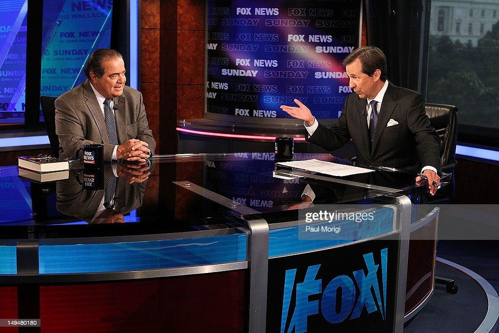 Chris Wallace (R) interviews U.S. Supreme Court Justice Antonin Scalia on 'FOX News Sunday' at the FOX News D.C. Bureau on July 27, 2012 in Washington, DC.