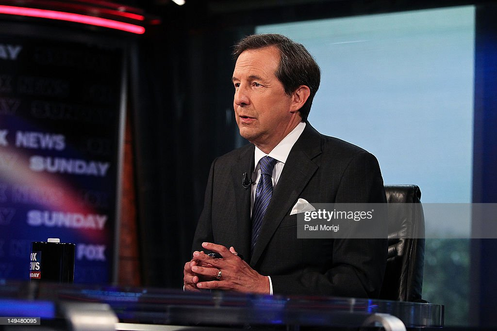 Chris Wallace takes part in an interview with U.S. Supreme Court Justice Antonin Scalia on 'FOX News Sunday' at the FOX News D.C. Bureau on July 27, 2012 in Washington, DC.