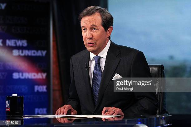 Chris Wallace takes part in an interview with US Supreme Court Justice Antonin Scalia on 'FOX News Sunday' at the FOX News DC Bureau on July 27 2012...