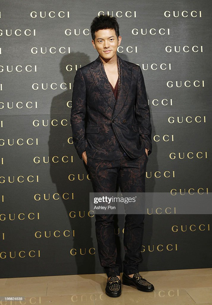 Chris Wang poses for a photography at the Gucci Flagship store opening at Taipei101 on November 22, 2012 in Taipei, Taiwan.