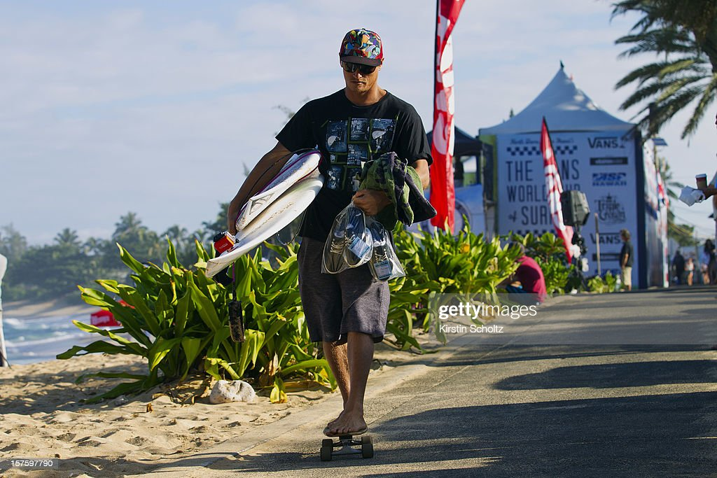 Chris Ward of the United States of America rides his skateboard as he leaves the competition site on December 4, 2012 in North Shore, Hawaii.