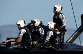 Chris Ward Ray Davies Glenn Ashby and skipper Dean Barker of Emirates Team New Zealand react after losing race 18 to Oracle Team USA skippered by...