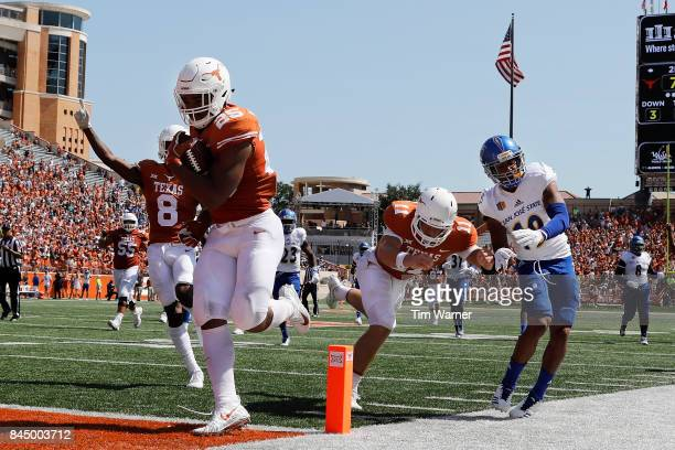 Chris Warren III of the Texas Longhorns rushes for a touchdown as Sam Ehlinger blocks Dakari Monroe of the San Jose State Spartans iin the second...