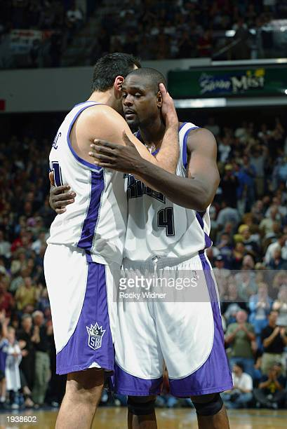 Chris Webber and Vlade Divac of the Sacramento Kings celebrate Webber's game winning shot during the NBA game against the Denver Nuggets at Arco...