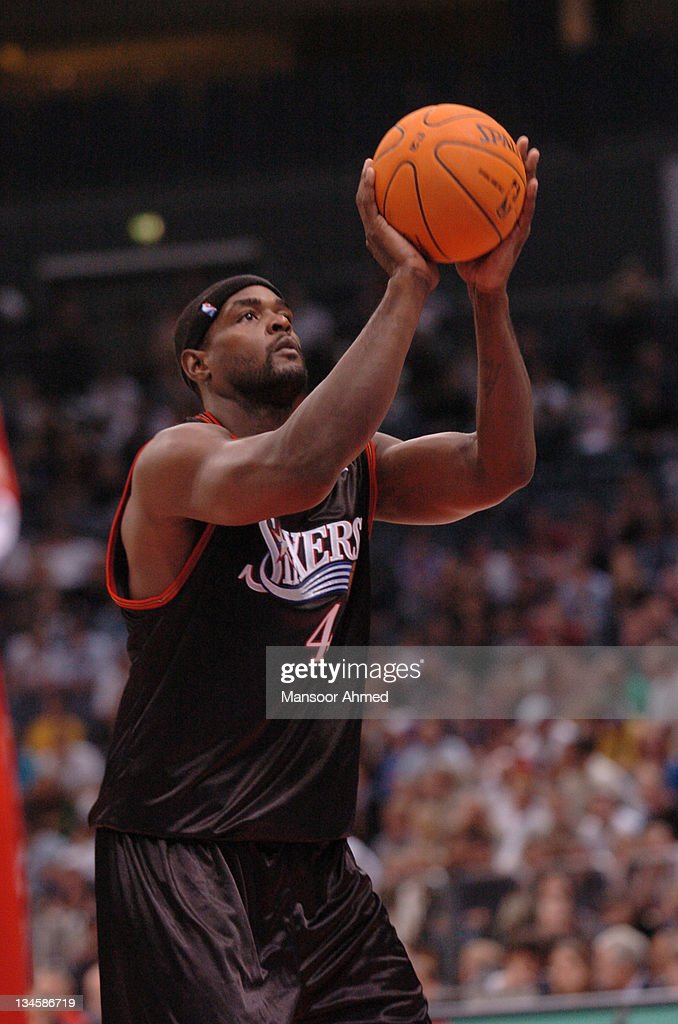 <a gi-track='captionPersonalityLinkClicked' href=/galleries/search?phrase=Chris+Webber&family=editorial&specificpeople=201510 ng-click='$event.stopPropagation()'>Chris Webber</a> lines up a free throw for Philadelphia 76ers during the NBA Europe Live Tour presented by EA Sports on October 11, 2006 at the Kölnarena in Cologne, Germany.