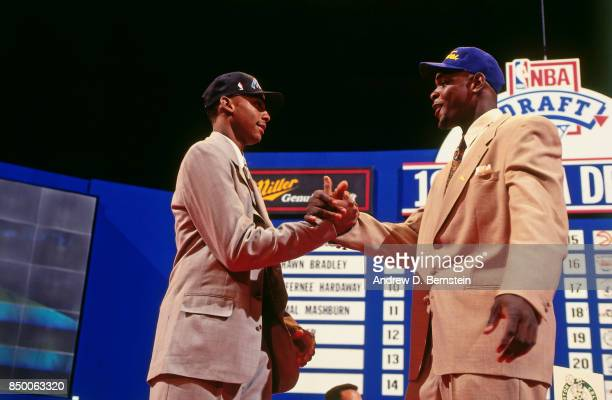 Chris Webber number one overall pick by the Golden State Warriors shakes hands with Penny Hardaway number three overall pick by the Orlando Magic...