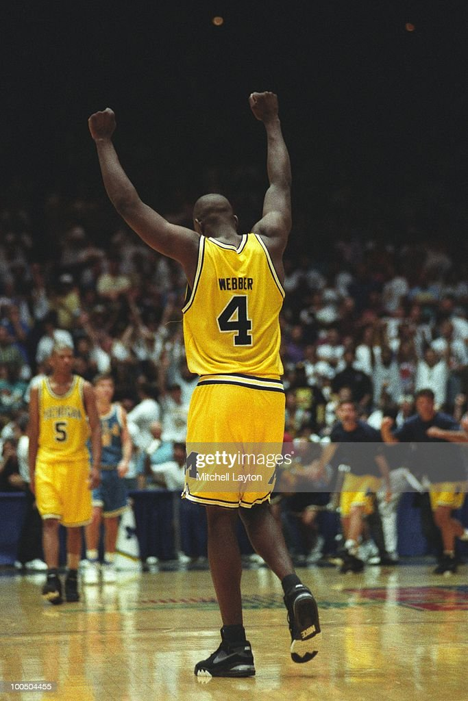 Chris Webber #4 of the Michigan Wolverines celebrates a shot during a NCAA second round basketball game at the McKale Center on March 21, 1993 in Tuscon, Arizona..