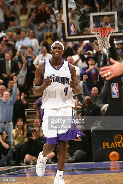 Chris Webber of the Sacramento Kings celebrates the 8379 victory over the Dallas Mavericks in game two of round one of the 2004 NBA Western...