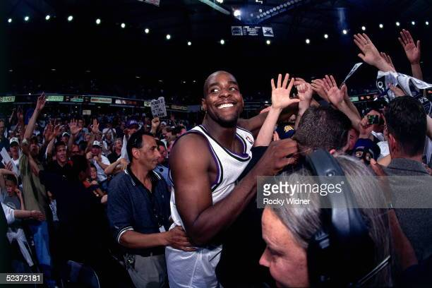 Chris Webber of the Sacramento Kings celebrates with fans after winning Game Three of the first round of the 1999 NBA Western Conference Playoffs...