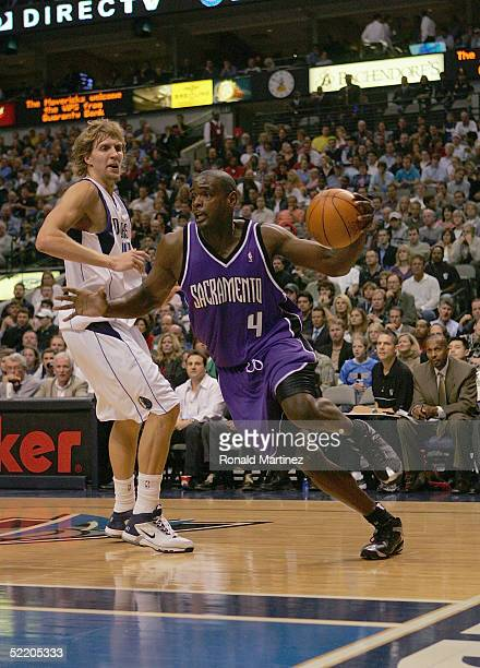 Chris Webber of the Sacramento Kings drives against Dirk Nowitzki of the Dallas Mavericks during the game at American Airlines Arena on November 2...