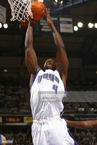 Chris Webber of the Sacramento Kings dunks against the Dallas Mavericks during game one of round one of the 2004 NBA Western Conference Playoffs on...