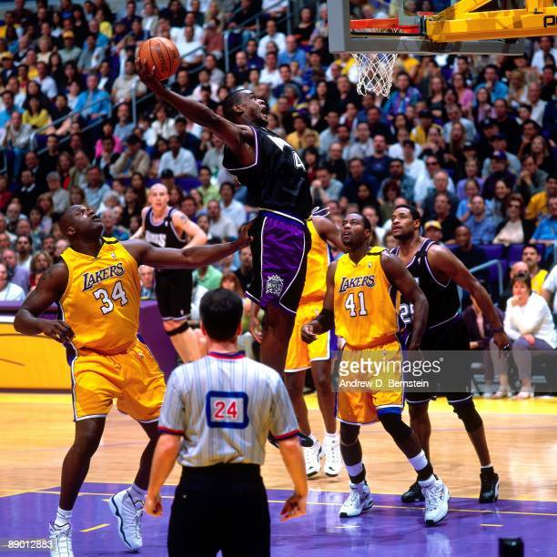 Chris Webber of the Sacramento Kings dunks against the Los Angeles Lakers in Game One of the Western Conference Quarterfinals during the 2000 NBA...