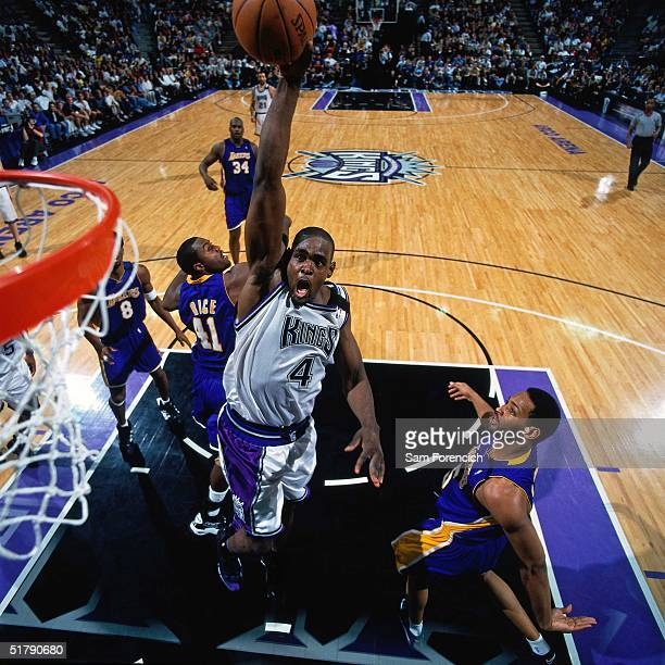Chris Webber of the Sacramento Kings goes for a dunk against the Los Angeles Lakers during the NBA game in Sacramento California NOTE TO USER User...