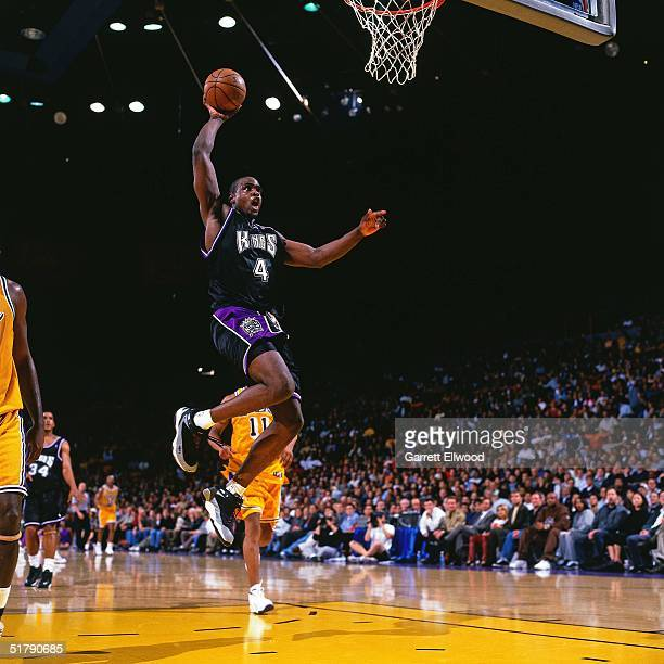 Chris Webber of the Sacramento Kings goes for a dunk against the Los Angeles Lakers during the NBA game in Los Angeles California NOTE TO USER User...