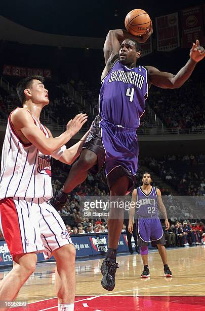 Chris Webber of the Sacramento Kings goes to dunk against Yao Ming of the Houston Rockets during the NBA game at Compaq Center on December 10 2002 in...