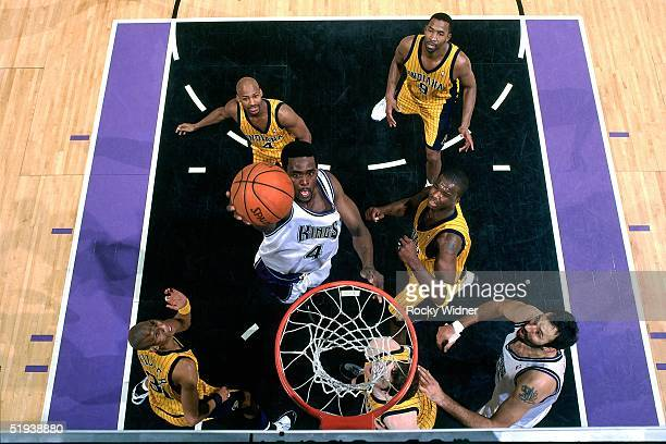 Chris Webber of the Sacramento Kings goes up for a layup against the Indiana Pacers during an NBA game on January 5 2001 at the Arco Arena in...