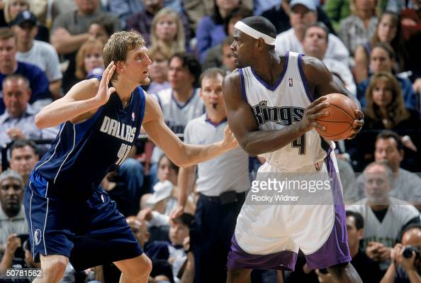 Chris Webber of the Sacramento Kings looks to drive on Dirk Nowitzki of the Dallas Mavericks during game two of the first round of the 2004 Western...