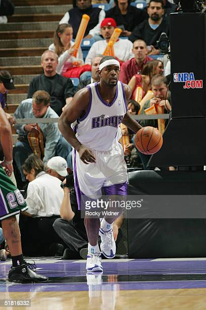 Chris Webber of the Sacramento Kings moves the ball during the game with the Milwaukee Bucks at Arco Arena on November 21 2004 in Sacramento...