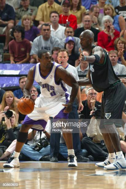 Chris Webber of the Sacramento Kings posts up Kevin Garnett of the Minnesota Timberwolves in Game six of the Western Conference Semifinals during the...