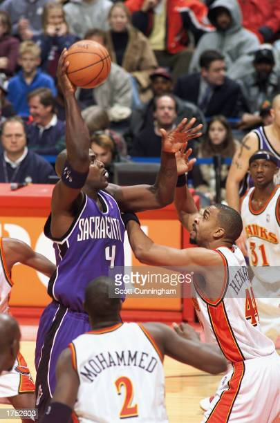Chris Webber of the Sacramento Kings puts a shot up over Alan Henderson of the Atlanta Hawks during the game at Philips Arena on January 24 2003 in...