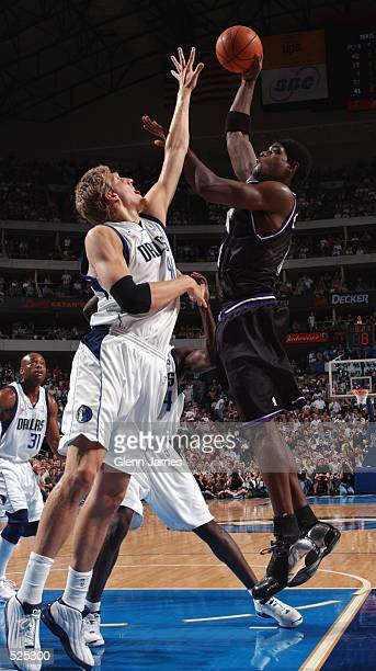 Chris Webber of the Sacramento Kings puts a shot up over Dirk Nowitzki of the Dallas Mavericks in game four of the Western Conference Semifinals...