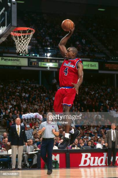 Chris Webber of the Washington Bullets dunks against the Sacramento Kings during a game played on December 16 1996 at Arco Arena in Sacramento...