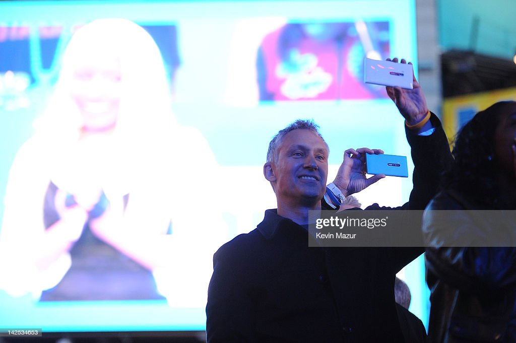 """Chris Weber President of Nokia attend as Times Square was brought to a standstill on April 6, 2012 as Nicki Minaj teamed up with Nokia to perform live for the launch of the Windows Phone-based Nokia Lumia 900 in North America, in New York City. Tens of thousands of people watched Nicki perform a medley of her hits before a prominent Times Square building was turned into a living, breathing entity in time to the unique Nokia Lumia 900 remix of her hit single 'Starships'. The building appeared to fill with water before a 60ft waterfall was seen to cascade down the side of the building. The reaction of the crowd was shown on nine massive electronic screens around the famous square making it one of the biggest LED displays ever seen and will be used in the video of Nicki's new Nokia Lumia 900 remix of 'Starships'. """"When Nokia came to me with the idea to make a building come alive and to perform in Times Square in front of my fans to celebrate the launch of the Nokia Lumia 900 there was only ever one answer. To see the idea on paper was amazing but to see it for real blew me away. It brought Times Square to a standstill. The absolute bonus for me is that my fans, who have been so loyal to me, are now part of the video for the Starships Nokia remix. Performing in my home town of NYC the same week as the release of my new album, Pink Friday: Roman Reloaded is amazing and it really is a dream come true."""" The Nokia Lumia 900 will be available in unique and eye-catching cyan blue and a matte black with a new high-gloss white version on sale later this month. To watch more of the amazing event go to www.facebook.com/nokiaus"""