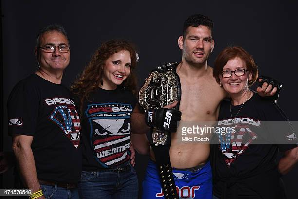 Chris Weidman and his family pose for a postfight portrait backstage during the UFC 187 event at the MGM Grand Garden Arena on May 23 2015 in Las...
