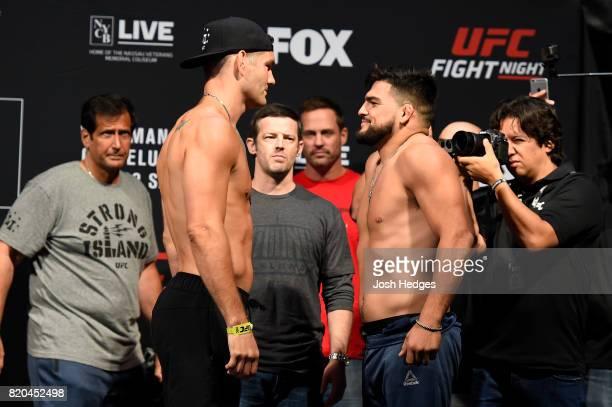 Chris Weidman and Kelvin Gastelum face off during the UFC Fight Night weighin inside the Nassau Veterans Memorial Coliseum on July 21 2017 in...