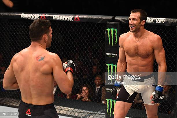 Chris Weidman and Luke Rockhold face off in their UFC middleweight championship bout during the UFC 194 event inside MGM Grand Garden Arena on...